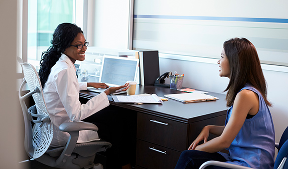 Physician speaking with patient